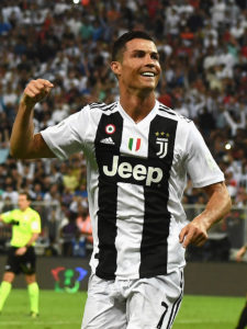JEDDAH, SAUDI ARABIA - JANUARY 16: Cristiano Ronaldo of Juventus celebrates after scoring his sides first goal during the Italian Supercup match between Juventus and AC Milan at King Abdullah Sports City on January 16, 2019 in Jeddah, Saudi Arabia. (Photo by Claudio Villa/Getty Images for Lega Serie A)