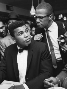 American boxer Muhammad Ali (born Cassius Marcellus Clay Jr. before his converting to Islam) with African-American Muslim minister, public speaker, and human rights activist Malcolm X (born Malcolm Little), after Ali beat Sonny Liston at world heavyweight championship. (Photo by Bob Gomel/Sygma/Sygma via Getty Images)