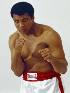 lowell-riley-muhammad-ali-showing-his-fists-dominant-white